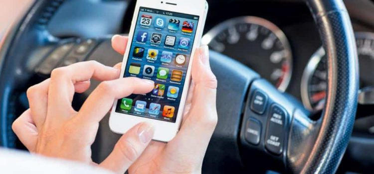 LISTENING TO MUSIC IS FINE, BUT THE POLICE TO BAN PHONE USE WHILE DRIVING